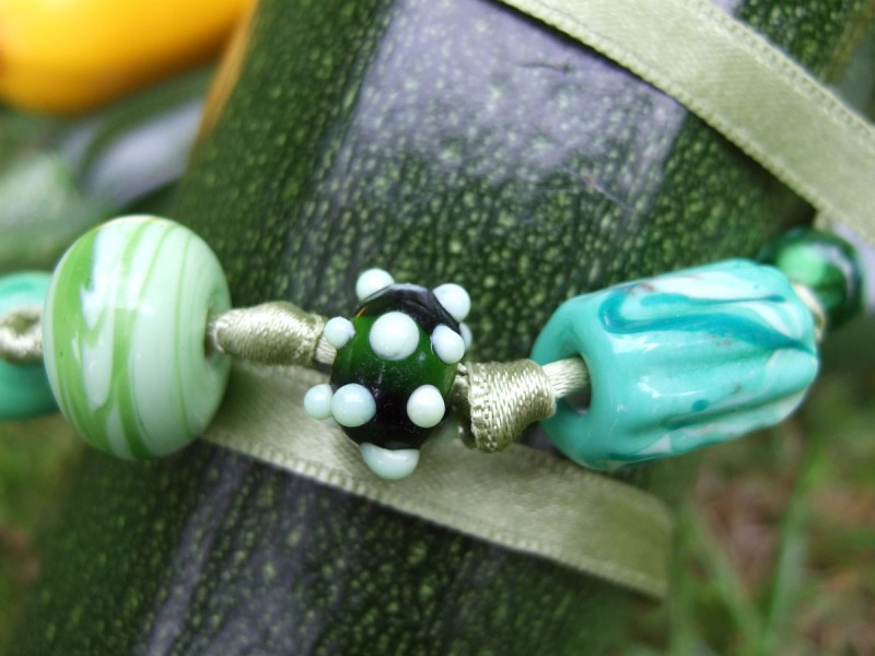 """Green Harvest""  five beads on ribbon"
