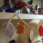 autumn leaf garland hanging from shelf