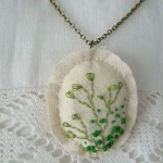 calico hand embroidered pendant