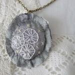 grey silk hand embroidered pendant