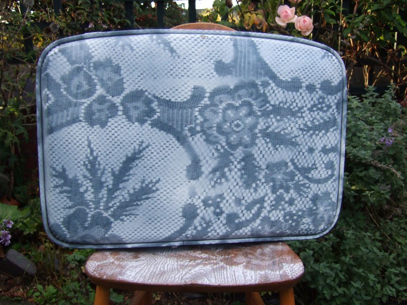 lace sprayed suitcase