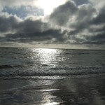 sunlight & clouds on Fairbourne beach